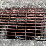 frp is alternative to steel grating - dangerous warped sharp open area rusty steel grating